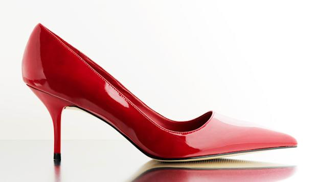 Fashionable women's red high heels shoe with reflection