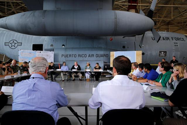 <p>President Donald Trump receives a briefing on hurricane relief efforts in a hangar at Muniz Air National Guard Base in Carolina, Puerto Rico, Oct. 3, 2017. (Photo: Jonathan Ernst/Reuters) </p>