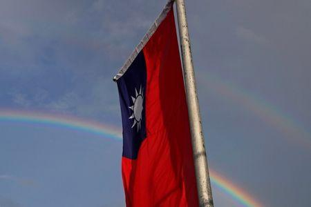 A double rainbow is seen behind Taiwanese flag during the National Day celebrations in Taipei
