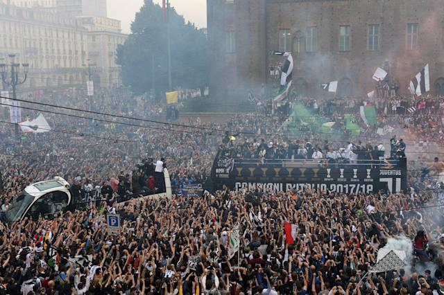 Soccer Football - Serie A - Juventus vs Hellas Verona - Turin, Italy - May 19, 2018 General view of the Juventus players celebrating winning the league on an open top bus surrounded by fans REUTERS/Massimo Pinca