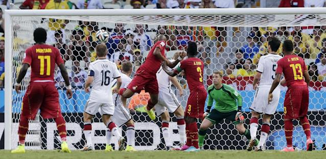 Ghana's Andre Ayew, center, scores his side's first goal during the group G World Cup soccer match between Germany and Ghana at the Arena Castelao in Fortaleza, Brazil, Saturday, June 21, 2014. (AP Photo/Matthias Schrader)