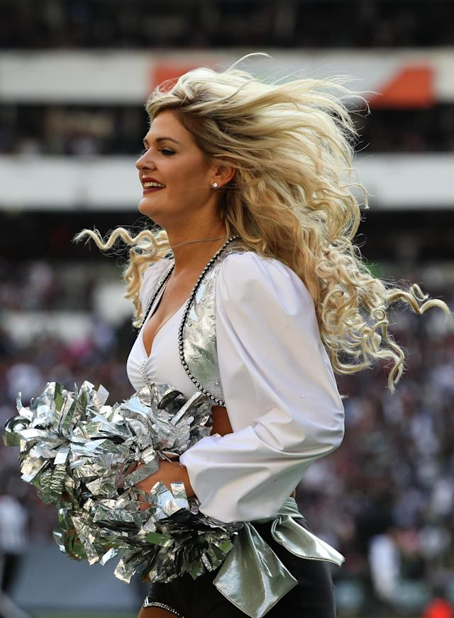 <p>A Oakland Raiders cheerleader dances during the first half against the New England Patriots at Estadio Azteca on November 19, 2017 in Mexico City, Mexico. (Photo by Buda Mendes/Getty Images) </p>