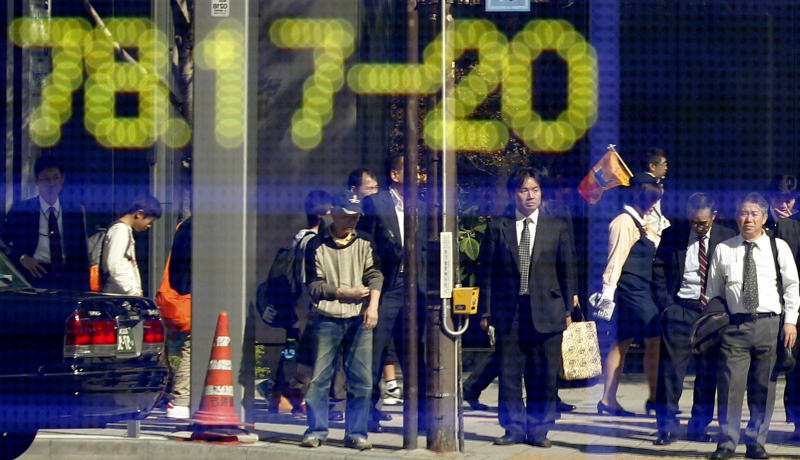 People are reflected on an electronic board of a securities firm, which shows the yen-dollar foreign exchange rate, a day after after the Bank of Japan weakened its currency to help Japanese exporters,  in Tokyo, Japan, Tuesday, Nov. 1, 2011. On Monday, The Bank of Japan says it sold yen and bought dollars during Tokyo trading in order to pull the yen down from a post-World War II high against the dollar.   (AP Photo/Koji Sasahara)