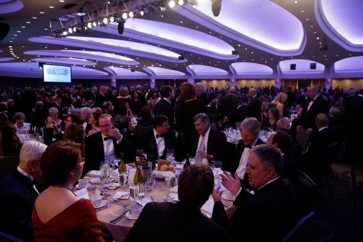 Attendees take their seats at the start of the White House Correspondents' Association dinner.