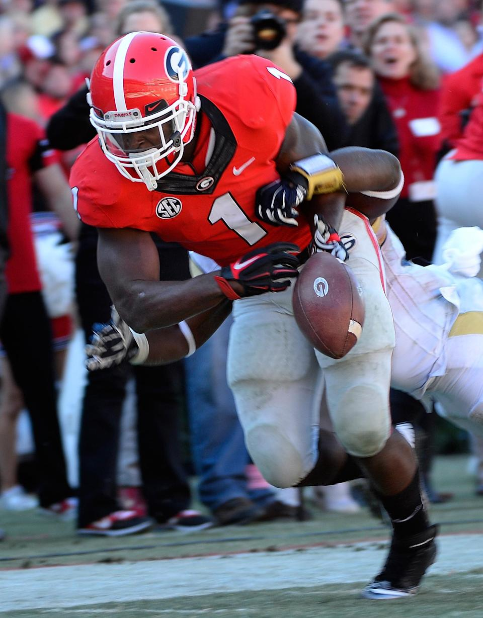 Georgia running back Sony Michel (1) fumbles the ball near the 1-yard line under pressure from Georgia Tech linebacker Quayshawn Nealy, rear, during the first half of an NCAA college football game Saturday, Nov. 29, 2014, in Athens, Ga. Georgia Tech recovered the ball. (AP Photo/David Tulis)