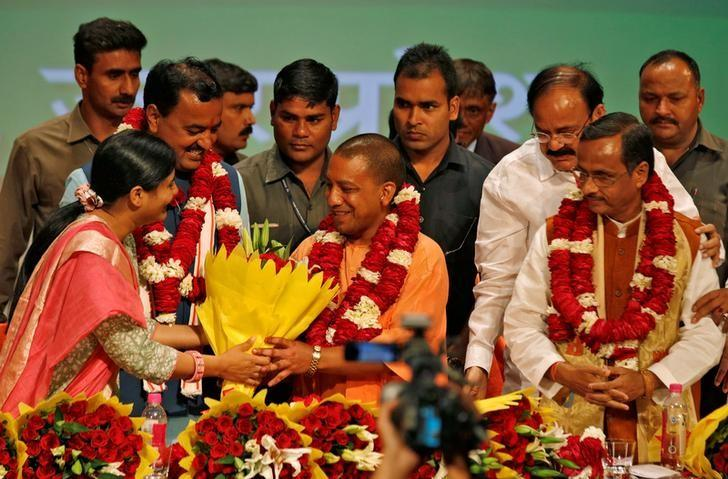 India's ruling Bharatiya Janata Party leader Yogi Adityanath is greeted after he was elected as Chief Minister of India's most populous state of Uttar Pradesh, during the party lawmakers' meeting in Lucknow