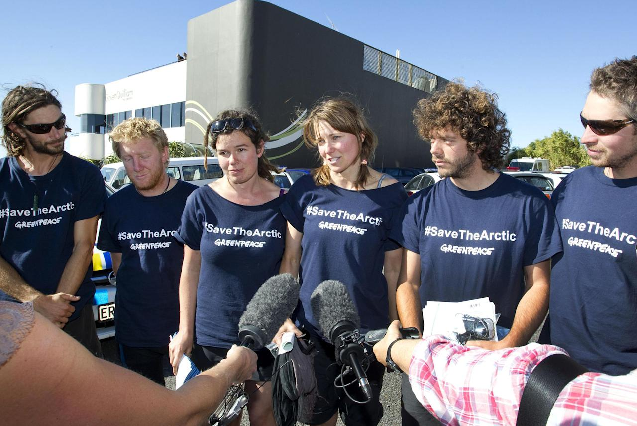 In this photo provided by Greenpeace, actress Lucy Lawless, fourth from left, and five Greenpeace activists, from left, Mike Buchanan, Raoni Hammer, Vivienne Hadlow, Shai Nades and Shayne Comino, speak to the media outside the central police station in New Plymouth, New Zealand, Monday, Feb. 27, 2012, after their release on bail on charges relating to protesting aboard Arctic oil-drilling ship, the Noble Discoverer, in Port Taranaki. Police on Monday arrested actress Lawless and the five Greenpeace environmental activists after the group spent four days protesting aboard the oil-drilling ship docked in New Zealand. (AP Photo/Greenpeace, Nigel Marple) NO SALES, NO ARCHIVES, EDITORIAL USE ONLY, MANDATORY CREDIT