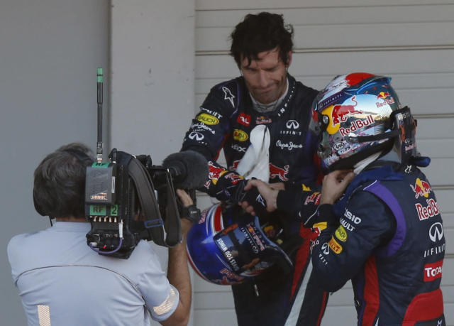 Second-placed Red Bull Formula One driver Mark Webber of Australia shakes hands with Red Bull Formula One driver Sebastian Vettel (R) of Germany after Vettel won the Japanese F1 Grand Prix at the Suzuka circuit October 13, 2013. REUTERS/Toru Hanai (JAPAN - Tags: SPORT MOTORSPORT F1)
