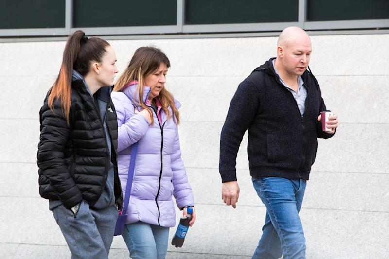 Family members of Louise Porton leave Warwickshire Justice Centre, Leamington Spa. January 26, 2019. A mother has appeared in court charged with murdering her two young daughters who died weeks apart. See SWNS story SWMDmurder. Louise Porton, 22, is accused of killing three-year-old Lexi Draper and 16-month old Scarlett Vaughan. Lexi was found dead at home in the early hours of January 15 last year after reports she was unconscious. A fortnight later on February 1, her little sister Scarlett died after reportedly falling ill at home. Porton, of Skiddaw, Rugby, Warks., appeared at Leamington Spa Magistrates' Court on Saturday (26/1) charged with two counts of murder. Wearing a white cardigan and grey bottoms, Porton spoke only to confirm her name, date-of-birth and address, during the two-minute hearing. She was remanded into custody and will appear via video link for her next appearance at Warwick Crown Court on Tuesday (29/1).