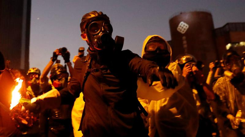 Hong Kong protesters fend off police with arrows, petrol bombs as unrest spreads