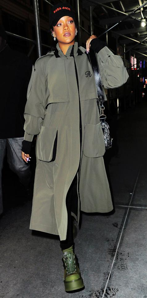 """<p>The music industry's resident bad gal stepped out in N.Y.C. on Monday in a mongrammed olive green trench coat, a message-bearing black baseball cap, and a pair of FENTY x PUMA Sneaker Zip Booties in Cypress ($390; <a rel=""""nofollow"""" href=""""https://click.linksynergy.com/fs-bin/click?id=93xLBvPhAeE&subid=0&offerid=484990.1&type=10&tmpid=23604&RD_PARM1=https%253A%252F%252Fwww.shopbop.com%252Ffenty-puma-sneaker-boot-zip%252Fvp%252Fv%253D1%252F1563408903.htm%253FcurrencyCode%253DUSD%2526extid%253DSE_froogle_SC_usa%2526cvosrc%253Dcse.google.PUMAA20277%2526cvo_campaign%253DSB_Google_USD%2526s_kwcid%253DAL%25213510%25213%2521%257Bcreative%257D%2521%257Bmatchtype%257D%2521%257Bplacement%257D%2521%257Bnetwork%257D%2521%2521%257Bkeyword%257D%2526ef_id%253DV72YwwAABGU1u9i4%253A20170322182422%253As&u1=ISRihannaSSFentyBootiesIJMarch"""">shopbop.com</a>). SHOOK. </p>"""