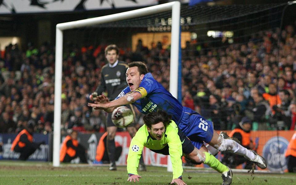 Terry flattens Messi - RUSSELL CHEYNE FOR THE TELEGRAPH