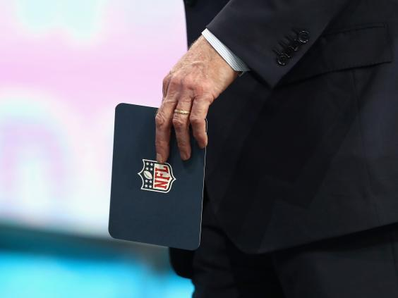 NFL commissioner Roger Goodell holds a cue card during the first round of the 2018 NFL Draft (Getty)