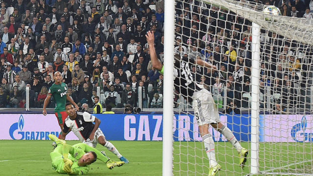 Lokomotiv Moscow's Aleksej Mirancuk (not seen) scores as other players watch the ball during the UEFA Champions League group D soccer match against Juventus FC at the Allianz Stadium in Turin, Italy, Tuesday, Oct. 22, 2019. (Andrea Di Marco/ANSA via AP)