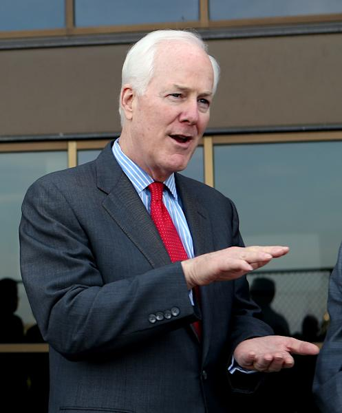 FILE - In this Wednesday, Dec. 4, 2013, file photo, United States Sen. John Cornyn talks to members of the media while attending NCAA college football practice at Baylor, in Waco, Texas. In a last-minute surprise late Monday, Dec. 9, 2013, U.S. Rep. Steve Stockman filed paperwork to challenge fellow Texas Republican and powerful incumbent Cornyn for the U.S. Senate next year. (AP Photo/Waco Tribune Herald, Rod Aydelotte, File)