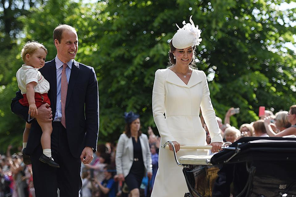 <p>Then there were four! Princess Charlotte was born in 2015, and her christening took place the same year, with Kate wearing one of her trusty Catherine Walker coats. Royal fans were delighted by pictures of a young George too. (PA Images)</p>