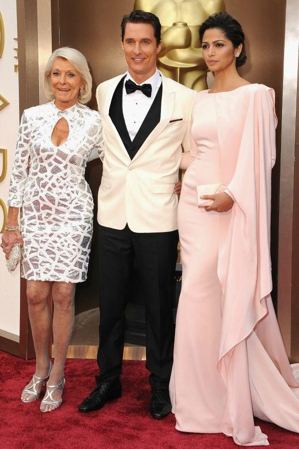 """<p>Talk about a proud mama. Mary Kathlene McCabe beams with joy while walking Matthew and his wife, Camila Alves, down the <a href=""""https://www.redbookmag.com/life/charity/features/g3120/golden-globes-then-and-now/"""" rel=""""nofollow noopener"""" target=""""_blank"""" data-ylk=""""slk:red carpet"""" class=""""link rapid-noclick-resp""""><u>red carpet</u></a> at the 2014 Academy Awards.</p>"""