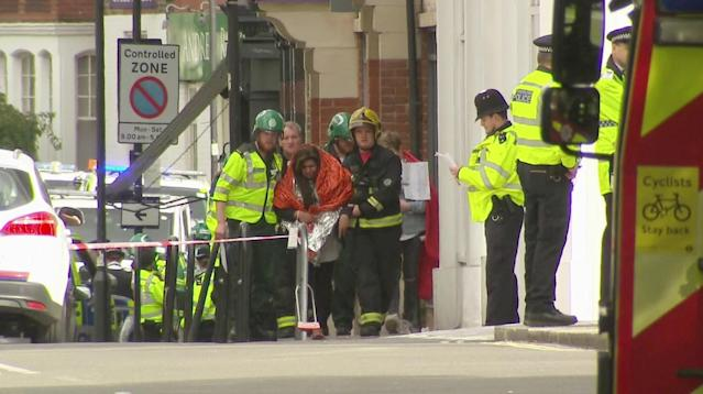 <p>In this image made from video, a woman with blankets wrapped around her is being escorted by emergency services near the scene of an explosion in London Friday, Sept. 15, 2017. (Photo: Sky via AP) </p>