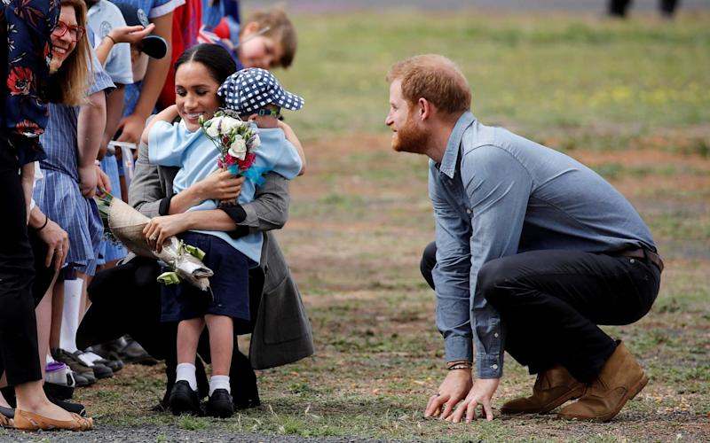 Five-year-old Luke Vincent give the Duchess a big hug as the royal couple arrive at Dubbo Airport - REUTERS
