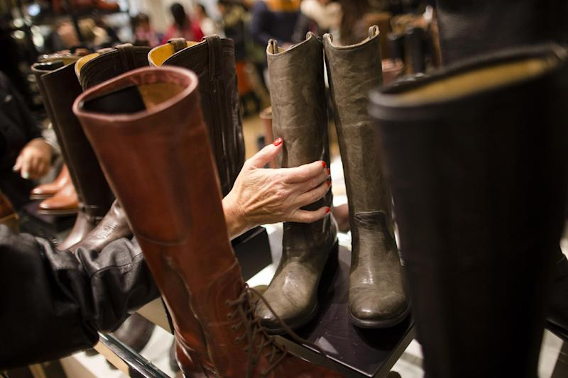FILE - In this Thursday, Nov. 28, 2013, file photo, a customer places a boot back in the shoe section of the Macy's Herald Square flagship store, in New York. The National Retail Federation estimates that sales over the four-day 2013 holiday weekend including Thanksgiving declined 2.9 percent from last year, marking the first drop since the group began tracking the figure in 2006. Overall spending for November and December is still expected to increase 3.9, but whether that plays out remains to be seen. (AP Photo/John Minchillo)