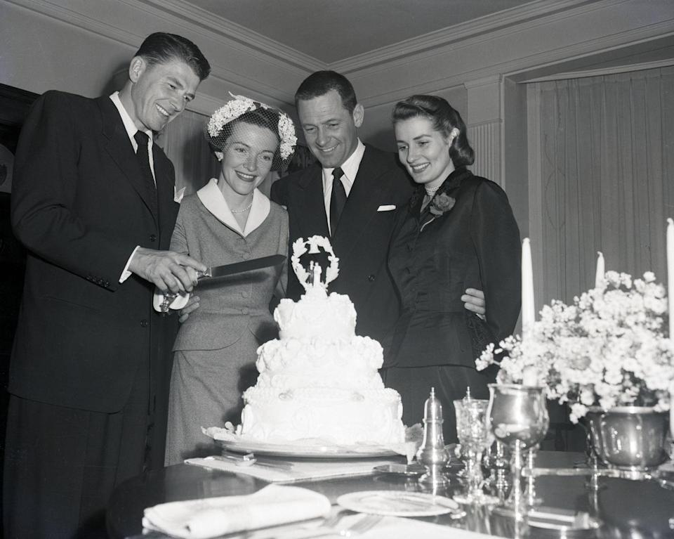 <p>They weren't in the White House just yet, so Hollywood actors Nancy Davis and Ronald Reagan tied the knot in a Hollywood home. Here, they cut the cake, while joined by their friends actor William Holden and his wife. </p>