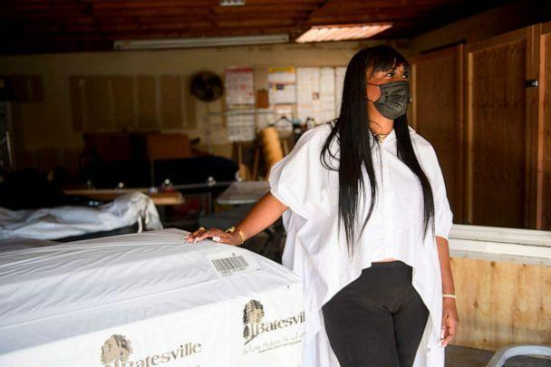 PHOTO: Candy Boyd, owner of the Boyd Funeral home, speaks during an interview next to an empty casket and cabinets built for expanded storage capacity of embalmed bodies awaiting burial due to the surge of Covid-19 deaths on Jan. 14, 2021 in Los Angeles. (Patrick T. Fallon/AFP via Getty Images, FILE)