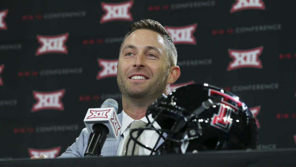 Texas Tech head football coach Kliff Kingsbury listens to a reporter's question during Big 12 media days in July. (Getty)