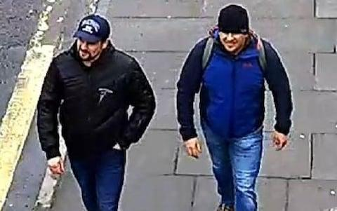 <span>The suspects head back towards Salisbury station; the Skripals were found slumped on a bench in the town centre three hours later</span> <span>Credit: Metropolitan Police </span>