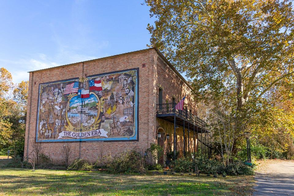 Old historic building with a mural of the Golden Era in the city of Jefferson, Texas