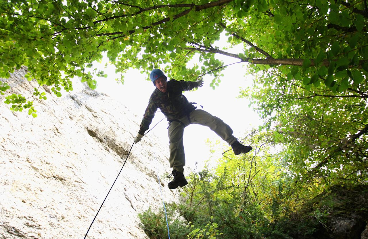 NUREMBERG, GERMANY - SEPTEMBER 26:  England bowler Graeme Swann flys head first down the rockface during an abseiling excercise at the England Cricket squad Pre Ashes Training Camp on September 26, 2010 near Nuremberg, Germany.  (Photo by Stu Forster/Getty Images)