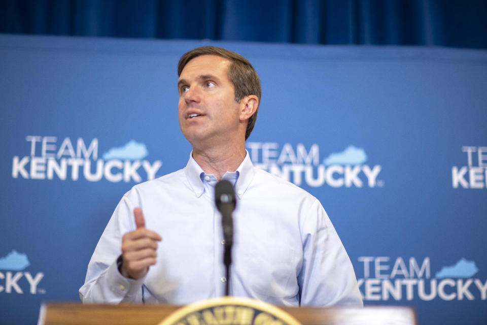 FILE - Kentucky Gov. Andy Beshear speaks during a news conference, Thursday, June 10, 2021 in Frankfort, Ky. Gov. Beshear on Thursday, June 24, 2021 dangled a $1,500 bonus meant to lure thousands of unemployed Kentuckians back to work, offering it as an alternative to an early cutoff of enhanced jobless benefits that Republicans and businesses blame for a workforce shortage. (Ryan C. Hermens/Lexington Herald-Leader via AP, Pool)