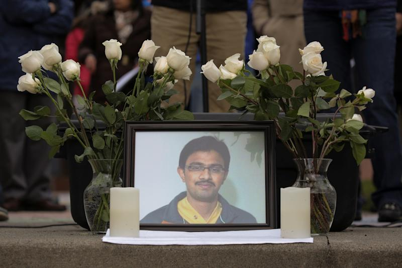 A picture of Srinivas Kuchibhotla, an immigrant from India who was recently shot and killed in Kansas, is surrounded by roses during a vigil in honor of him at Crossroads Park in Bellevue, Washington, U.S. March 5, 2017.  (David Ryder / Reuters)
