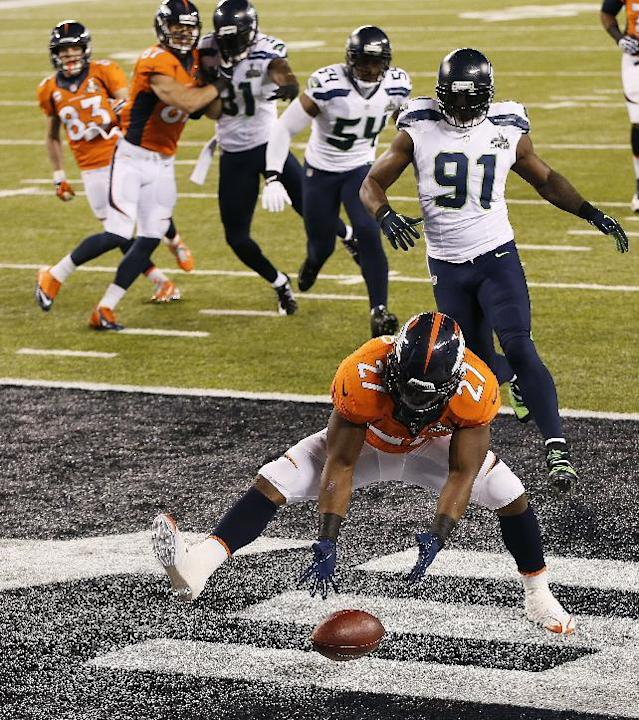 Denver Broncos running back Knowshon Moreno (27) recovers a fumble in the end zone for a safety after a bad snap in the first half of the NFL Super Bowl XLVIII football game against the Seattle Seahawks, Sunday, Feb. 2, 2014, in East Rutherford, N.J. (AP Photo/Kathy Willens)