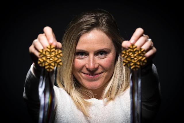 French skiing champion Tessa Worley poses with her World Cup women's giant slalom gold medals during a photo session in Paris on April 11, 2017 (AFP Photo/Lionel BONAVENTURE)