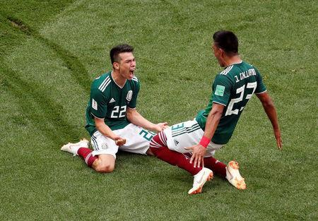 Soccer Football - World Cup - Group F - Germany vs Mexico - Luzhniki Stadium, Moscow, Russia - June 17, 2018 Mexico's Hirving Lozano celebrates scoring their first goal with Jesus Gallardo REUTERS/Christian Hartmann