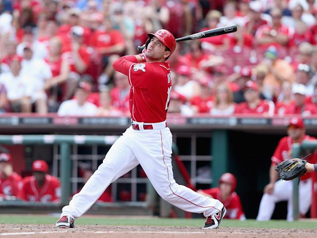 CINCINNATI, OH - JULY 07: Joey Votto #19 of the Cincinnati Reds hits the ball during the game against the Seattle Mariners at Great American Ball Park on July 7, 2013 in Cincinnati, Ohio. (Photo by Andy Lyons/Getty Images)