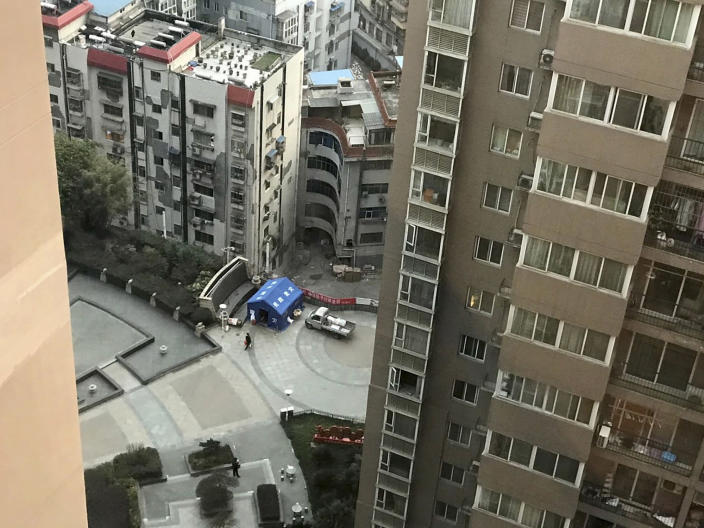 In this photo taken Feb. 24, 2020, and released by Chen Chi-chuan, a view from the room at the Vienna International Hotel where Chen Chi-chuan, 51, a Taiwanese electrical and plumbing contractor has lived in since Jan. 28 in Shiyan city in central China's Hubei province. Chen and about 1,000 other Taiwanese citizens are stuck behind doors in locked-down Chinese cities because their government cannot agree with China on how to arrange charter flights. Some are losing business income, risking too many absences from work and wondering how their children, if also stranded, will make up lost school days. (Chen Chi-chuan via AP)