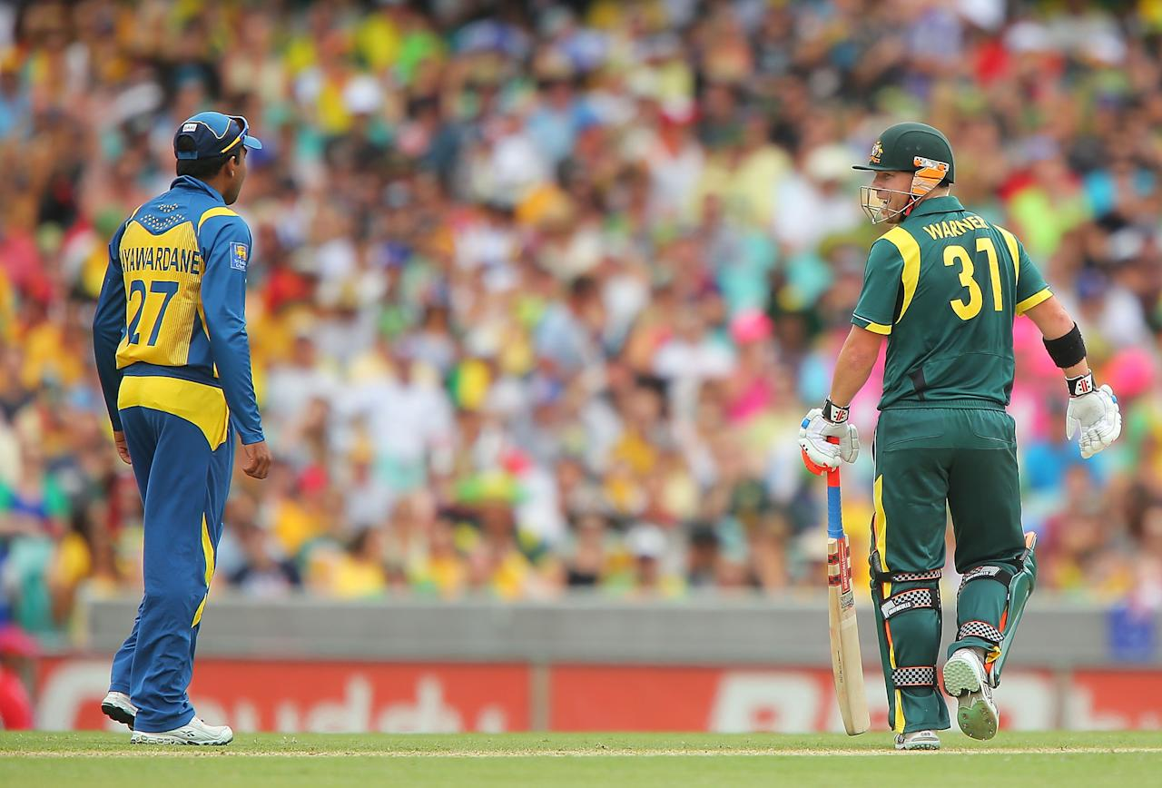 SYDNEY, AUSTRALIA - JANUARY 20:  David Warner of Australia and Mahela Jayawardena of Sri Lanka share words  during game four of the Commonwealth Bank one day international series between Australia and Sri Lanka at Sydney Cricket Ground on January 20, 2013 in Sydney, Australia.  (Photo by Brendon Thorne/Getty Images)