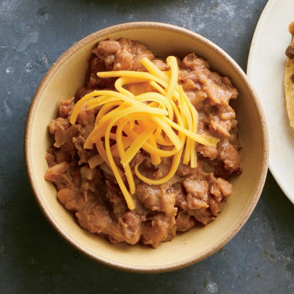 """<p>Mashing half the beans retains just a bit of texture while keeping them creamy and cheesy.</p> <p><a href=""""https://www.myrecipes.com/recipe/cheesy-smoky-pinto-beans"""">Cheesy, Smoky Pinto Beans Recipe</a></p>"""