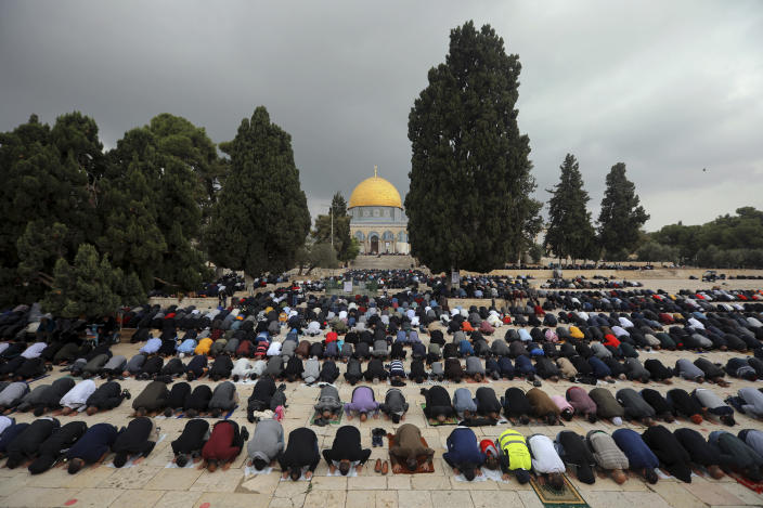 """Muslim men pray during Friday prayer, next to the Dome of the Rock Mosque in the Al Aqsa Mosque compound in Jerusalem's old city, Friday, Nov. 6, 2020. The Palestinian leadership has condemned the United Arab Emirates' decision to forge ties with Israel as a """"betrayal,"""" but it could lead to a tourism bonanza for Palestinians in east Jerusalem as Israel courts wealthy Gulf travelers. (AP Photo/Mahmoud Illean)"""