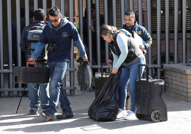 Homicides agents arrive at a private school after a boy shot a teacher and wounded several students, in Torreon