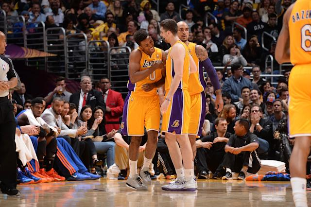 LOS ANGELES, CA - MARCH 25: Nick Young #0 and Ryan Kelly #4 of the Los Angeles Lakers celebrate during their game against the Los Angeles Lakers at Staples Center on March 25, 2014 in Los Angeles, California. (Photo by Andrew D. Bernstein/NBAE via Getty Images)