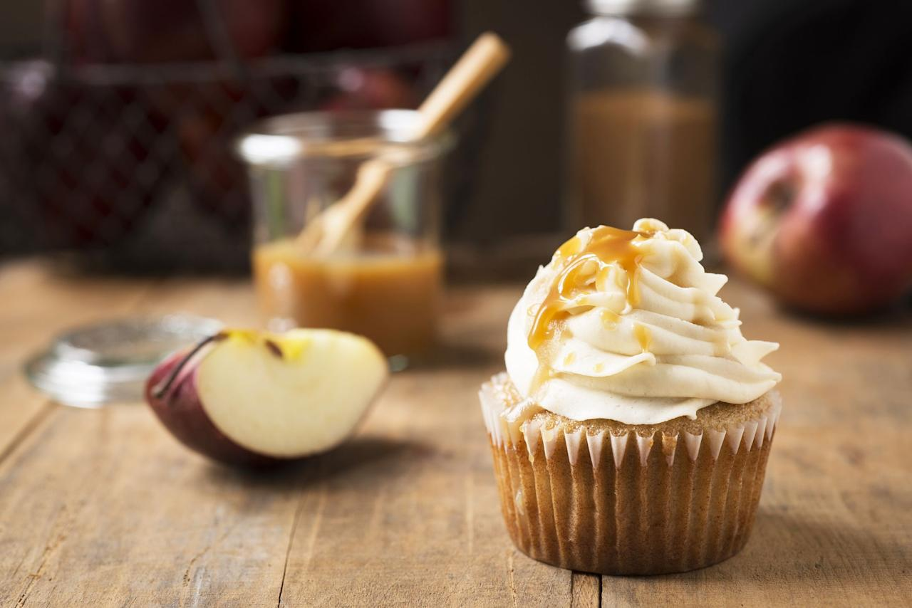 """<p>Of course, there's nothing wrong with serving a <a href=""""https://www.countryliving.com/food-drinks/g1368/thanksgiving-pies/"""">homemade pie</a> at your <a href=""""https://www.countryliving.com/food-drinks/g637/thanksgiving-menus/"""">Thanksgiving feast</a>, but this year, it's time to make your <a href=""""https://www.countryliving.com/food-drinks/g1384/thanksgiving-desserts/"""">holiday dessert</a> spread even sweeter with these Thanksgiving cupcakes. Dinner guests of all ages (adults, kids, and everyone in between) will enjoy each one of these <a href=""""https://www.countryliving.com/food-drinks/g4696/fall-cupcakes/"""">fall flavored cupcakes</a>. The great thing about cupcakes is because they're smaller in size, you can enjoy one (or two) and not feel a bit of guilt. No matter what kind of bite size cake you're in the mood for, there's a recipe on this list you'll want to bake asap. If you like <a href=""""https://www.countryliving.com/food-drinks/g620/pumpkin-dessert-recipes/"""">pumpkin desserts</a>, the dulce de leche pumpkin coconut cupcakes with cinnamon cream cheese frosting, the pumpkin cheesecake swirl cupcakes, or the pumpkin cookie dough cupcakes will definitely satisfy your cravings. There are also plenty of <a href=""""https://www.countryliving.com/food-drinks/g975/apple-dessert-recipes/"""">apple treats</a> on this list, including the caramel apple cupcakes, the apple snickerdoodle cupcakes, and the spiced apple cider cranberry cupcakes. This roundup is filled with many other delicious flavors, including the dark chocolate cupcakes with creamy peanut butter frosting, the spice cake cupcakes with cinnamon cream cheese frosting, and the chai latte cupcakes. You might as well go ahead and save a few of these recipes to bake in the days leading up to November 28—with so many delectable options, it will be impossible to choose just one.<br></p>"""