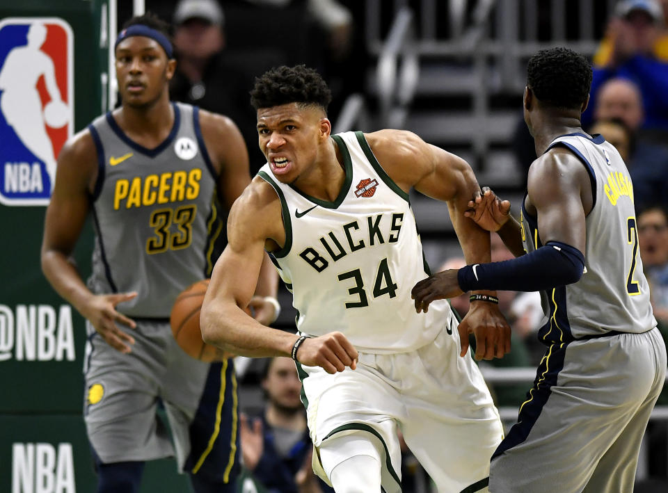 MILWAUKEE, WISCONSIN - MARCH 07: Giannis Antetokounmpo #34 of the Milwaukee Bucks reacts after scoring against Myles Turner #33 of the Indiana Pacers at Fiserv Forum on March 07, 2019 in Milwaukee, Wisconsin.  NOTE TO USER: User expressly acknowledges and agrees that, by downloading and or using this photograph, User is consenting to the terms and conditions of the Getty Images License Agreement. (Photo by Quinn Harris/Getty Images)