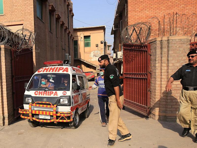 An ambulance car transports the body of Tahir Naseem, who was shot dead in a court room: EPA/BILAWAL ARBAB