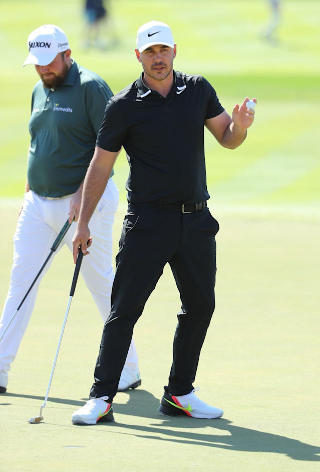"<div class=""caption""> Koepka acknowledges the crowd on the ninth green during Round 1 in Abu Dhabi </div> <cite class=""credit"">Warren Little</cite>"