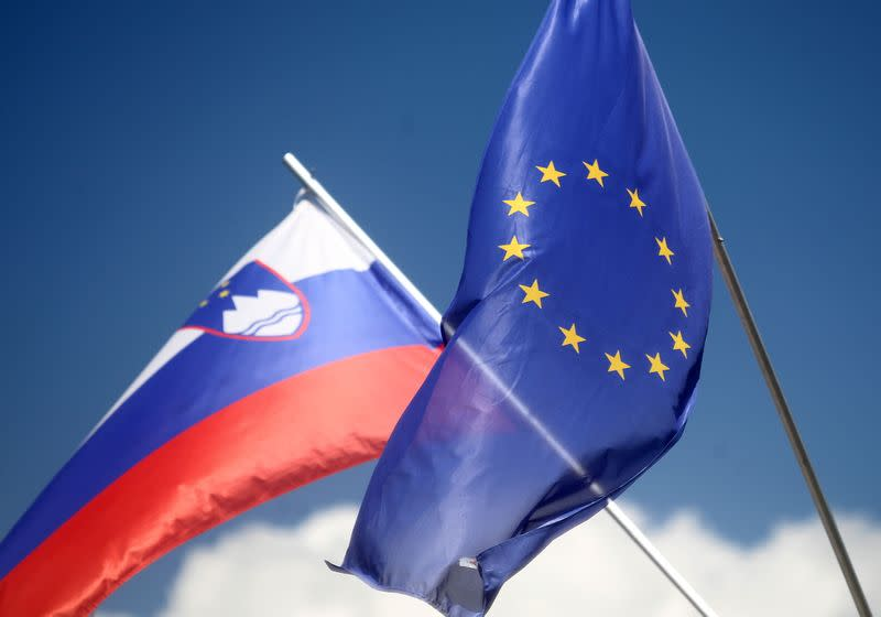 FILE PHOTO: European and Slovenian flags flutter in Medvode