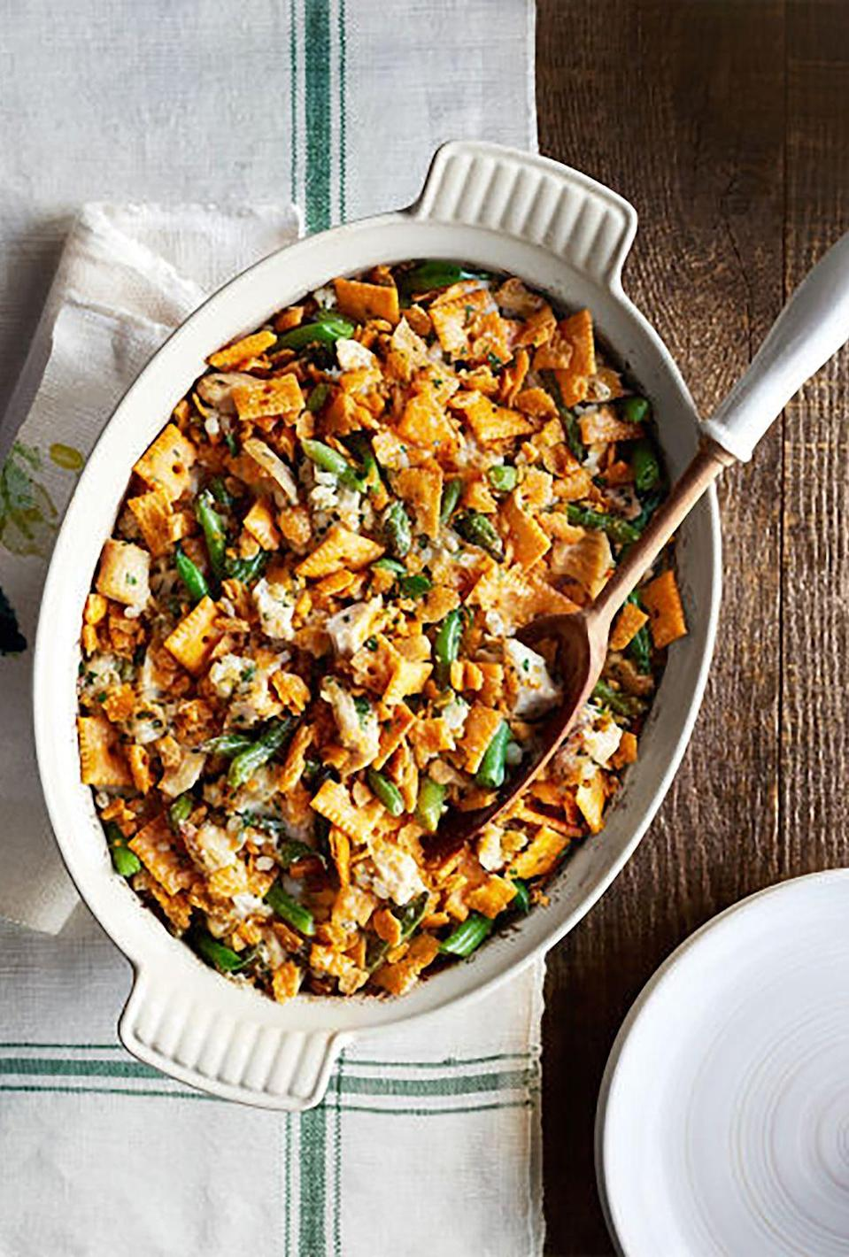 """<p>With creamy chicken and green beans topped with iconic cheese crackers, this dish is a nostalgic nod to Nanas everywhere.</p><p><strong><a href=""""https://www.countryliving.com/food-drinks/recipes/a36147/green-bean-barley-chicken-casserole/"""" rel=""""nofollow noopener"""" target=""""_blank"""" data-ylk=""""slk:Get the recipe"""" class=""""link rapid-noclick-resp"""">Get the recipe</a>.</strong></p><p><strong><a class=""""link rapid-noclick-resp"""" href=""""https://www.amazon.com/Bakeware-Krokori-Rectangular-Aquamarine-Rectangula/dp/B074Z5X8MT/?tag=syn-yahoo-20&ascsubtag=%5Bartid%7C10050.g.3726%5Bsrc%7Cyahoo-us"""" rel=""""nofollow noopener"""" target=""""_blank"""" data-ylk=""""slk:SHOP BAKING DISHES"""">SHOP BAKING DISHES</a><br></strong></p>"""