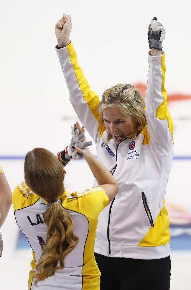 Manitoba skip Jennifer Jones (R) celebrates her gold medal with teammate third Kaitlyn Lawes after defeating Alberta during the Scotties Tournament of Hearts in Moose Jaw, Saskatchewan, February 22, 2015. REUTERS/Todd Korol (CANADA - Tags: SPORT CURLING)