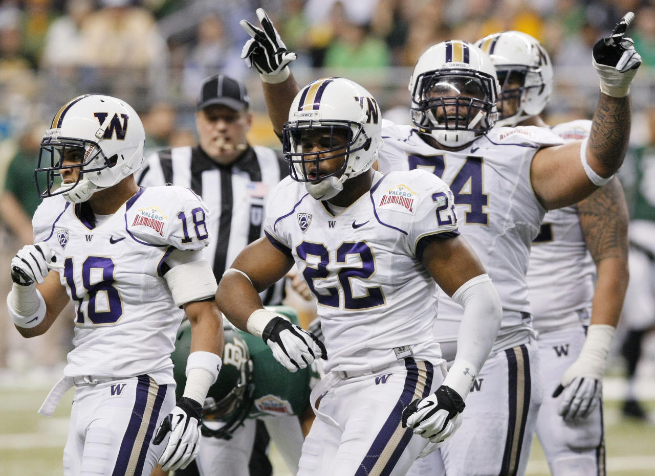 Washington's Josh Shirley, center, Gregory Ducre, left, and Alameda Ta'amu celebrate a sack during the first half of the Alamo Bowl college football game against Baylor, Thursday, Dec. 29, 2011, at the Alamodome in San Antonio. (AP Photo/Darren Abate)